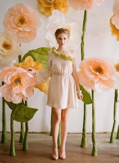 DIY tutorial for making these life-size flowers from Ruche (via Design Sponge) plus 9 other Paper Flower Backdrop ideas for inspiration (for tutorial, click on slideshow and on the explanation accompanying this photo, click on the Design Sponge link)
