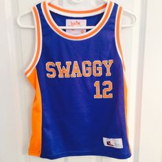 """Bieber Jersey Tour Tank Top Bought at Justin Bieber's Believe tour. Fits like a small! Never worn. Says """"Swaggy"""" on the front and """"Bieber"""" on the back. Justin Bieber Tops Tank Tops"""