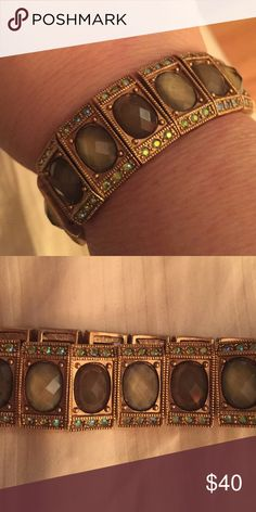 Olive green Lia Sophia bracelet This is a Lia Sophia army green colored bracelet that has hints of greenish stones. Lia Sophia Jewelry Bracelets