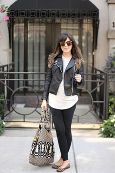 Leggings and moto jackets are always a good idea. Keep your look simple by opting for flats and a printed carryall.