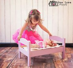 Cute photo shoot for a 2 year old girl and her baby doll