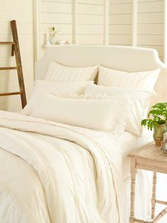 """#PineConeHill Mod Pintuck Ivory Duvet Cover and Shams. We can't get enough of dressmaker details, like these """"stripes"""" of gentle pintucking on an all-season cotton duvet."""