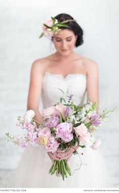 Bouquet with lilac flowers and greens! Photographer: Catherine Mac | Dress: Alana van Heerden - Fashion and Bridal Design | Earrings: Shelley & Harry | Bracelet: Dear Rae | Hair & Make-up: Helga Strydom | Flowers & Décor: Anli Wahl - Flowers & Event Styling |