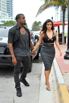Kim Kardashian Photos - Kim Kardashian looks to have left her underwear at home as she heads out for an early dinner with boyfriend Kanye West in Miami. As Kim checked out her outfit in the reflection of her car, it became apparent that the reality star was not wearing any underwear as she showed off her see-through grey skirt. - Kim Kardashian and Kanye West in Miami 2