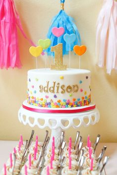 Don't just sprinkle on the fun, sprinkle on the love with this adorable first birthday theme and décor inspiration. Your little girl will feel like the belle of the ball with these amazing outdoor celebration ideas—including a colorful, customized cake.