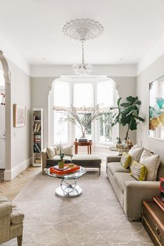 Living room with  herringbone floors with architectural details and modern furniture