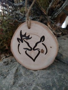 Perfect for the hunting couple - a buck and doe Christmas ornament. Approximate dimension: 3 diameter and 1/2 thick I dont know what type of wood I used - I would guess birch but I cant guarantee it. I do know it burn nicely and smells nice! Know a couple getting married or celebrating an anniversary? I can add a date below the deer to make this a personalized ornament. Let me know the date you would like in the notes when purchasing. The ornament is finished off with a piece of twine for…