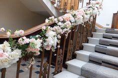 staircase garland of roses, hydrangea and blossom - silk flower garland decorating the staircase at Haigh Hall