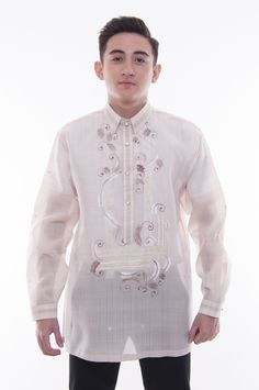 Made out of Jusi, this Barong has the Pina effect in brown and has hand-painted details woven into the white and gold two-tone embroidery. Mens Hottest Fashion, Mens Fashion, Barong Tagalog, Filipino Wedding, Filipino Culture, Collar Designs, Chino Shorts, All About Fashion, Chef Jackets