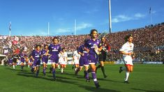 Gabriel Batistuta (left) of Fiorentina and Paolo Maldini (right) of AC Milan lead their teams onto the pitch before a Serie A match at the Artemio Franchi Stadium in Florence, Italy. Paolo Maldini, Gabriel, Football Pictures, Vintage Football, Ac Milan, Pitch, Sports, Florence Italy, Image
