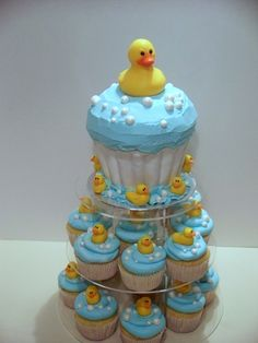 Rubber Ducky Baby Shower - Lemon with lemon filling and bc. Bottom section of large cupcake covered in fondant. Bubbles and small ducks are fondant w/ tylose. Large Duck is purchased hollow duck made of white chocolate. Duck Cupcakes, Duck Cake, Giant Cupcakes, Baby Shower Cupcakes, Shower Cakes, Cupcake Cakes, Cupcake Art, Cupcake Display, Ducky Baby Showers