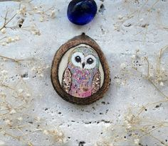 Rainbow colored little owl made in pyrograph and painted wood slice  Perfect to hang in your home or as a gift  #owl #paintig #art #handmade #woodburn