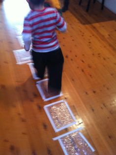 bubble wrap indoor hopscotch - greatest idea ever .. can you imagine if your child has had a bad day at school and coming home to this!!! SO COOL!!!!
