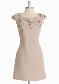 brias villa applique dress.  lovely in soft beige. good for those with a tendency to spill coffee?... $94.99