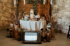 CFEC Decor: Vintage Decor, Gold Lanterns, Wooden Vases, Faux Greenery, Cake Stands  P.C. T and V Photography Eclectic Wedding, Turquoise Flowers, Desert Rose, Cake Table, Twinkle Lights, Island Weddings, Boho Wedding, Earthy, Wedding Venues