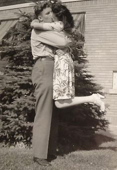 Your kisses make me lift my legs. Vintage 1940's Snapshot of WWII Soldier Kissing His Girl Big Time!