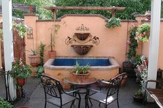Courtyard fountain | Spanish style courtyard with pergola; a… | Flickr