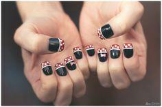 Disney Minnie Mouse Finger Nail Design.