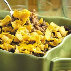 Easy Hamburger Crunch:  2 lbs. ground beef 1 T. onion, minced 2 10-3/4 oz. cans tomato soup 1 t. chili powder 4 c. corn chips 8-oz. pkg. shredded cheese