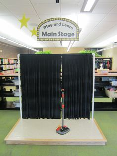 Play and Learn at the library: Arts theme - Main stage where kids can step up and be creative through dramatic play.  This has been a big hit with kids of all ages. A volunteer built it for our library.