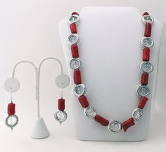 Fun statement piece!! Necklace features red-dyed bamboo coral complimented by silver circle beads that have clear crystal beads at its center.
