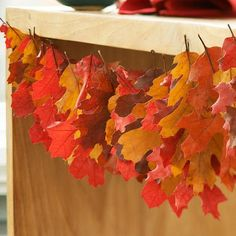 Make a gorgeous autumn leaf garland!  Either use real leaves with Modge Podge or cut from different colors of paper and string together.