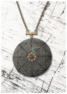 Danna Gussman's polymer pendant has an air of mystery and occult past, due to her excellent use of faux antique detail, as seen on The Polymer Arts blog, http://www.thepolymerarts.com/blog/9494