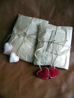 An old sewing pattern used as wrapping paper with twine and felt hearts.