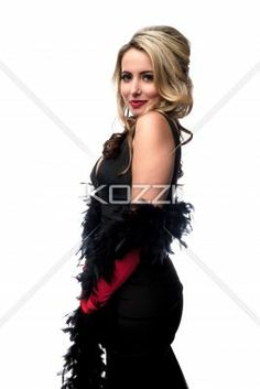 side view of a beautiful young woman posing. - Side view portrait of a beautiful young woman posing over white background, Model: Nadine Yelovich