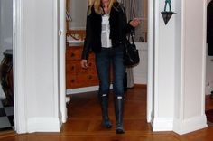 Girl in black leather jacket, jeans and hunter boots