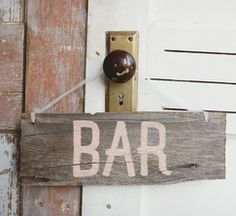 """To hang on the bar for a little extra decoration? But I would paint it to say """"Drinks."""""""