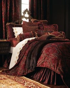 "Isabella Collection Maria Christina Bed Linens - HorchowIsabella Collection ""Maria Christina"" Bed Linens  Plush chenille damask bed linens in deep red and chocolate, enhanced with fancy trimmings. Taffeta dust skirts have a 16"" drop. Pinch-pleat damask curtains are lined with cotton."