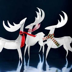 Pretty paper reindeer that can be tree ornaments or table decorations. Die cut files for most machines included.