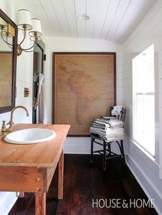 Bathroom With Vintage Map Mix woods for a laid-back look.   House & Home #bathroom
