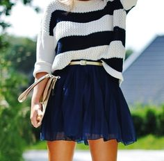 Skater skirt and oversized sweater are a fashionable combo...but only if you're a size 4!