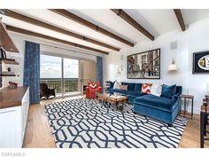 4851 Bonita Bay BLVD #2103, Naples, FL 34134 | Blue velvet sofa, graphic rug and draperies, wood ceiling beams.  Love this room!| Tavira High Rise in Bonita Bay | Naples Modern Homes for Sale