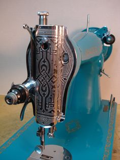 Might be a later model 15-91 but a scroll faceplate always looks stunning on these sewing machines.