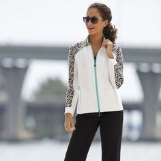 Jacquard Jacket from Monroe and Main. Exquisite jacquard-weave detailing across the yoke defines and sets apart this comfy stretch knit top.