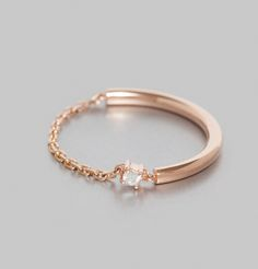 1gr pink gold ring, single 0,025ct diamond.    O Fée adds an industrial element to timeless style with this pink gold chain and sold gold design. Created with a