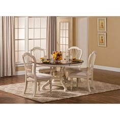 Hillsdale Pine Island 5 Piece Round Dining Set with Wheat Back Chairs Set includes dining table and 4 chairsConstructed of solid woodOld white finish with dark Round Dining Table Sets, Kitchen Dining Sets, Solid Wood Dining Set, 7 Piece Dining Set, Table And Chair Sets, Dining Room Sets, Dining Room Table, Kitchen Tables, Kitchen Ideas