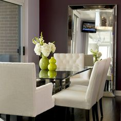 This Chicago dining room is simply divine. Features our Omni Leaner Mirror & Lola Chairs.