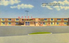 "Holiday Village Motel Grand Rapids, Minnesota Postcard - ""Hwy's 2 & 169. Television, Wall-to-Wall carpeting,. Individual room thermostats, Tile baths, complete Hotel service. Coffee shop adjacent."""