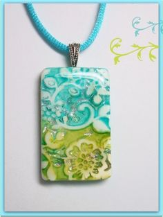 Lots of beautiful polymer clay jewelry on this site