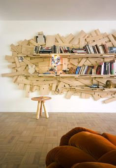 I came across this ultra-fun bookshelf at the Sao Paulo home of designer Humberto Campana, and thought it would be the perfect treat for this Sunday. Humberto and his brother Fernando designed it using as inspiration their award-winning Favela chair, 1991. How crazy is that back panel made from different pieces of scrap wood? Love, love, love! If you want to take a complete tour of Humberto's fab pad go here.