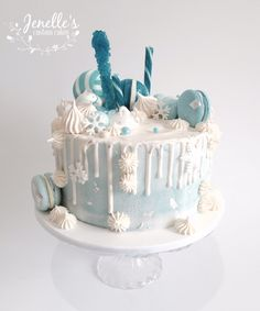 Frozen inspired drip cake. By Jenelle's Custom Cakes.