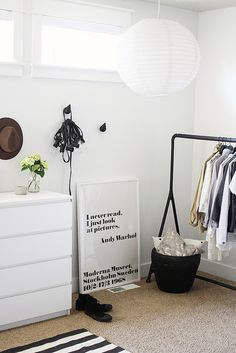 Wondering how to hang your new #festoonlights? Bunch together on one hook. We love this monochrome bedroom with white washed walls and a simple black and white rug. Perfect