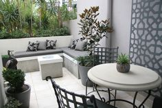 Outdoor Courtyard Design with Custom Upholstery Daybed & Laser Cut Steel Wall Art - www.brannellyoutdoor.com.au