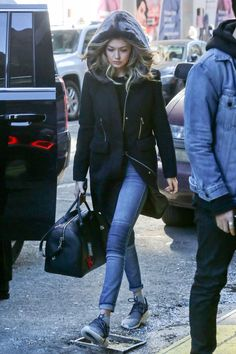 13 February Gigi Hadid was spotted out and about in New York looking cool and casual in a parka and jeans.   - HarpersBAZAAR.co.uk