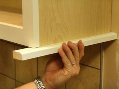 under cabinet molding kitchen cabinets | How to Install a Kitchen Cabinet Light Rail