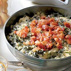 Warm Kale-and-Asiago Dip is an update to hot spinach dip featuring bacon and trendy kale.